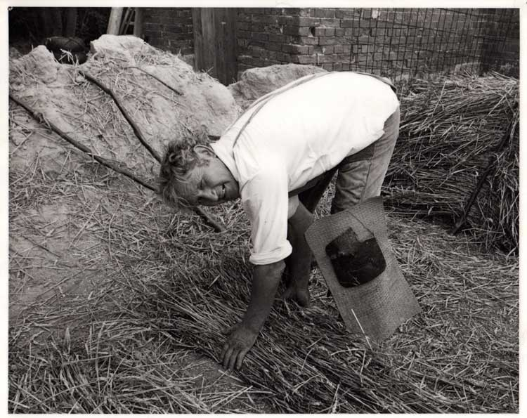 My grandad making up a yelm (bunch of straw)