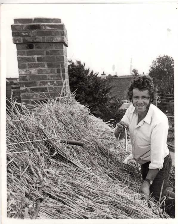 Steve Shelley thatching a roof